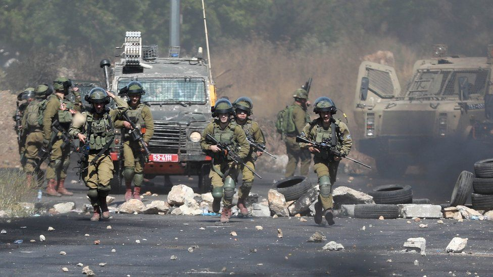 Violent clashes in West Bank as Palestinians protest over Israeli air strikes in Gaza
